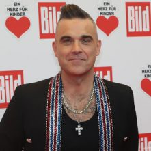 Robbie Williams poepte per ongeluk in eigen hand